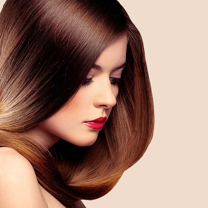 Woman with strong and silky hair   The Dermatology Institute of America Logo Dermatologist Formulated Skincare Products and Beauty Product Evaluations