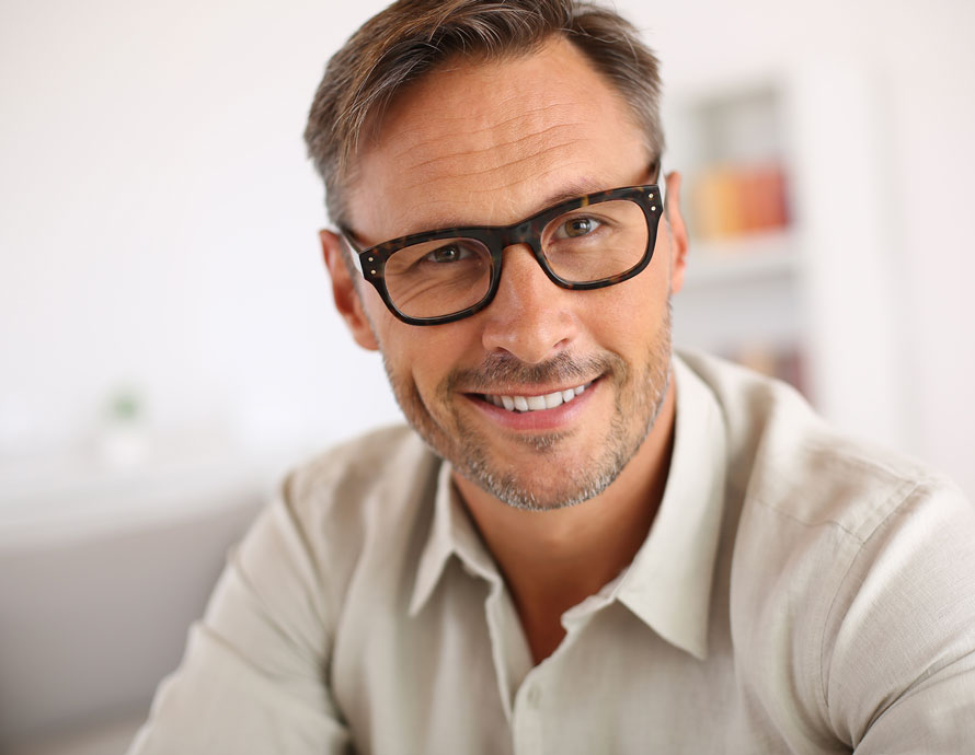 Man with glasses and normal skin | Skincare for Men Dermatology Institute of America Dermatologist Formulated Skincare Products and Beauty Evaluations